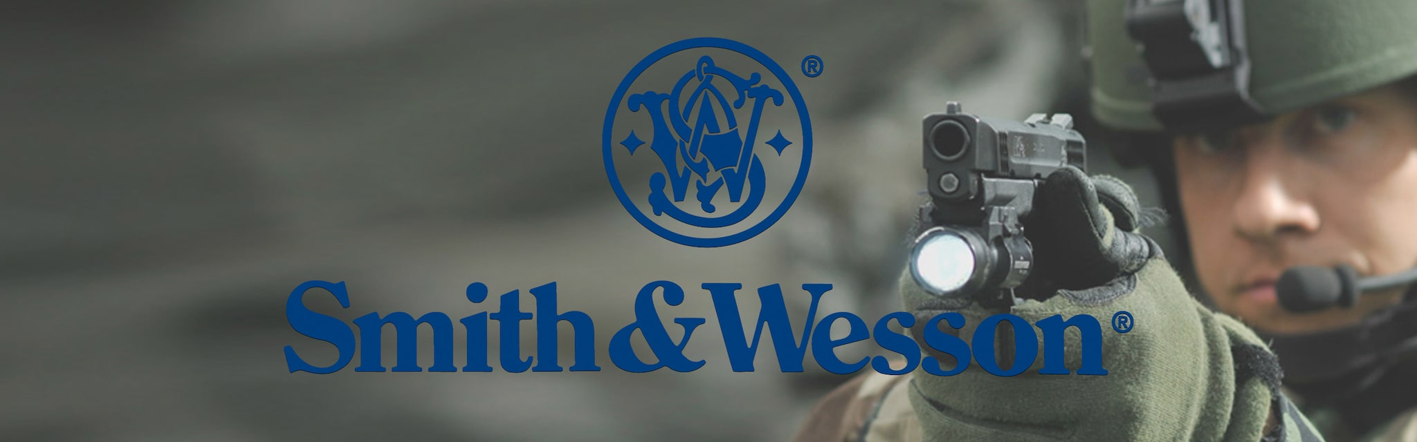 smith and wesson brand banner man aiming handgun with light