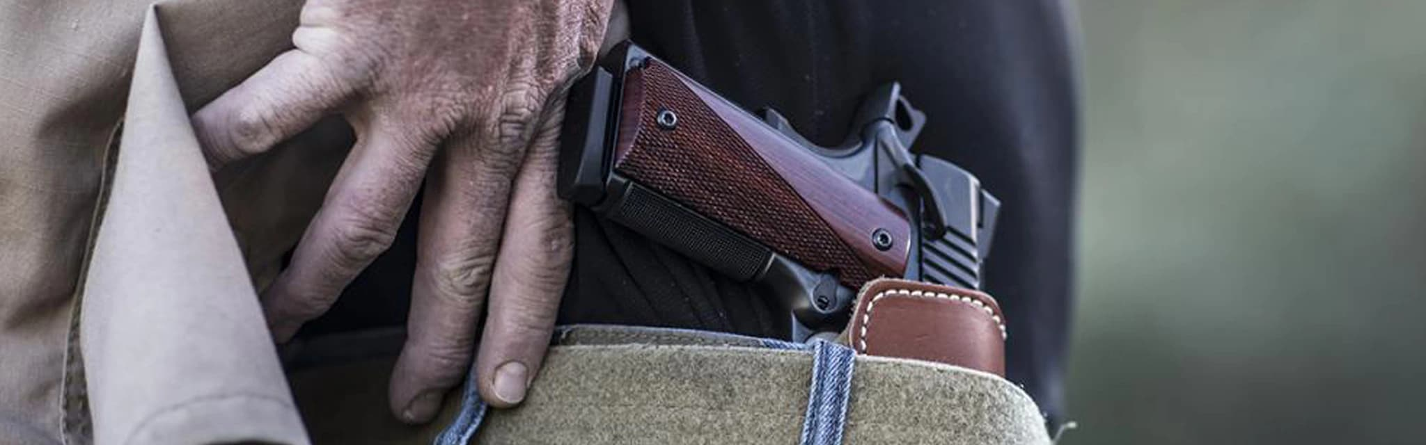 Concealed carry - close up of a pistol in a man's holster
