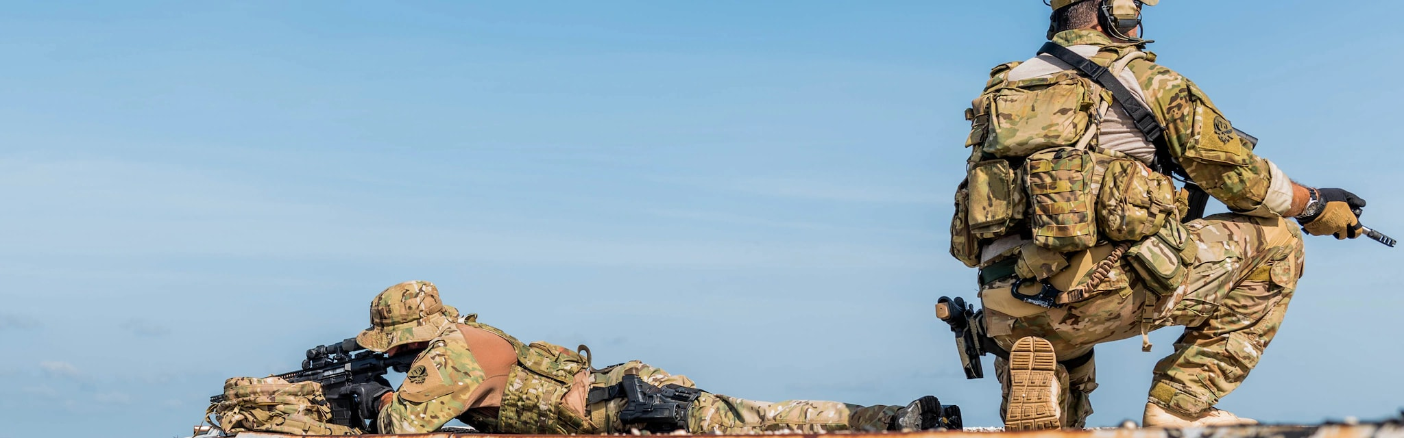 Tactical Lifestyle - Soldiers in field uniforms keeping a lookout