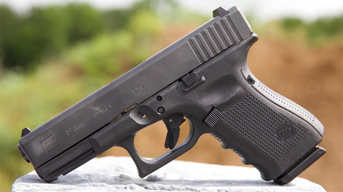 glock 19 displayed on stone