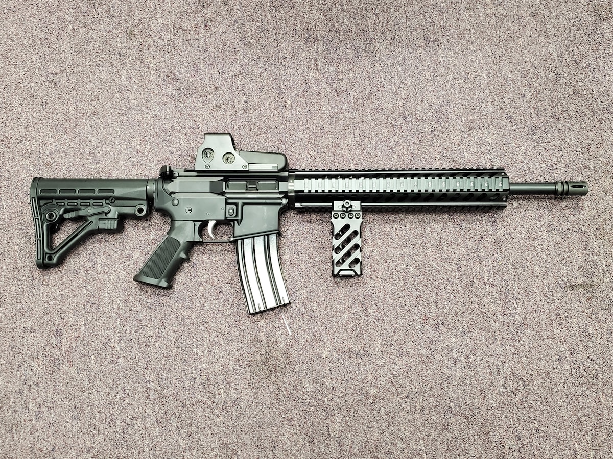 ANDERSON MANUFACTURING fully loaded ar15 with red dot and forward grip