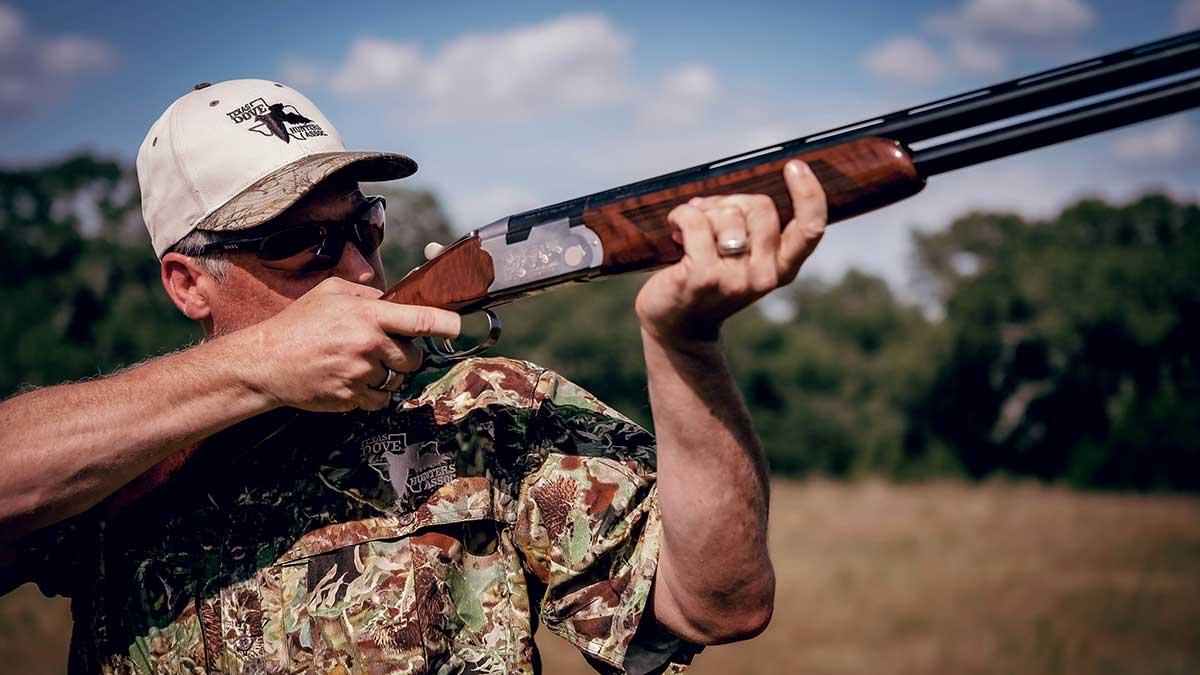 man with duck hunting shotgun