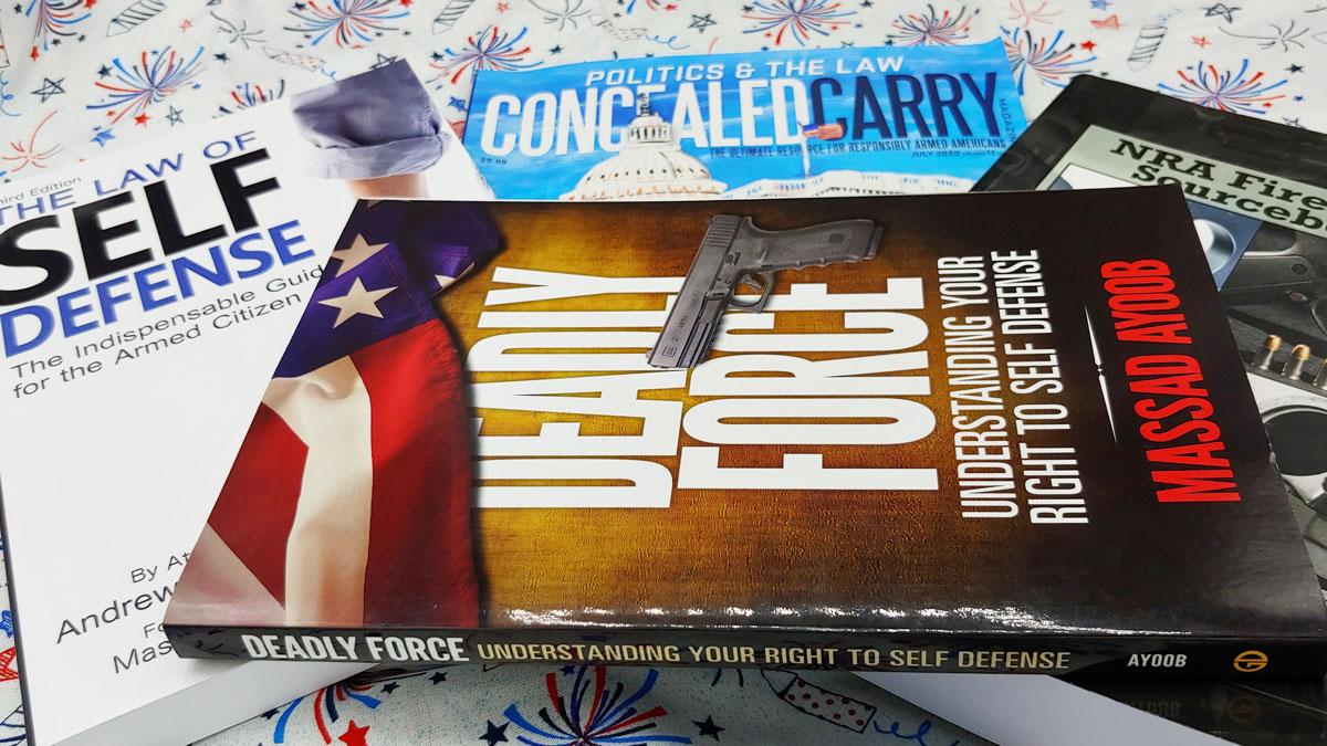 gun law books on table