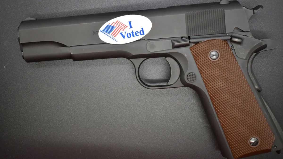 handgun with an i voted sticker