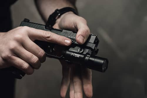 hands holding archon type b with flashlight