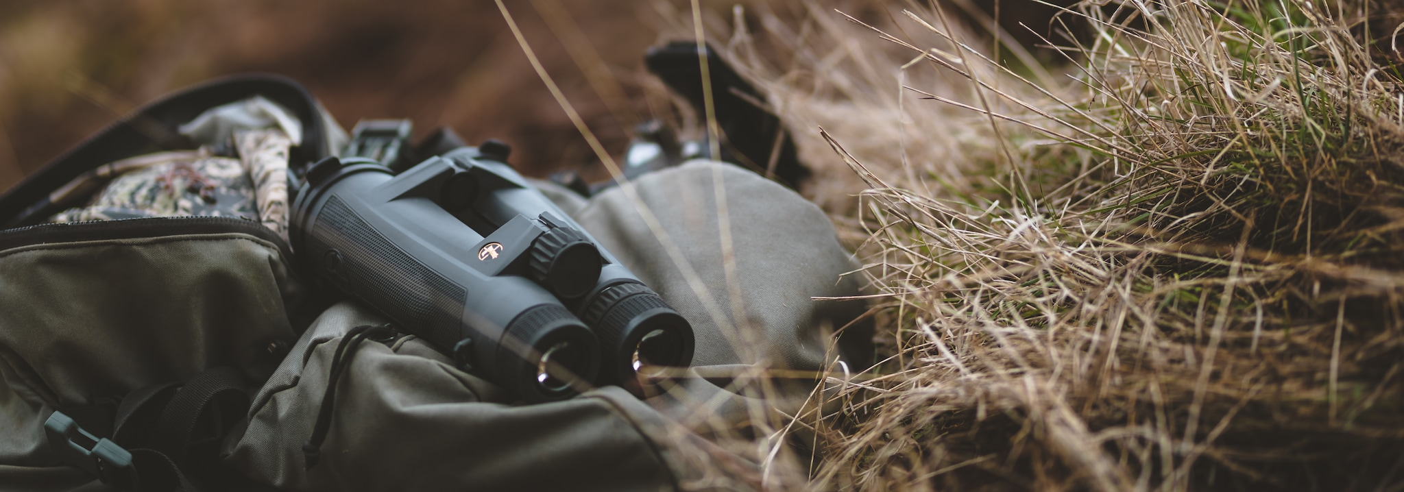 Leupold binoculars laying in the grass