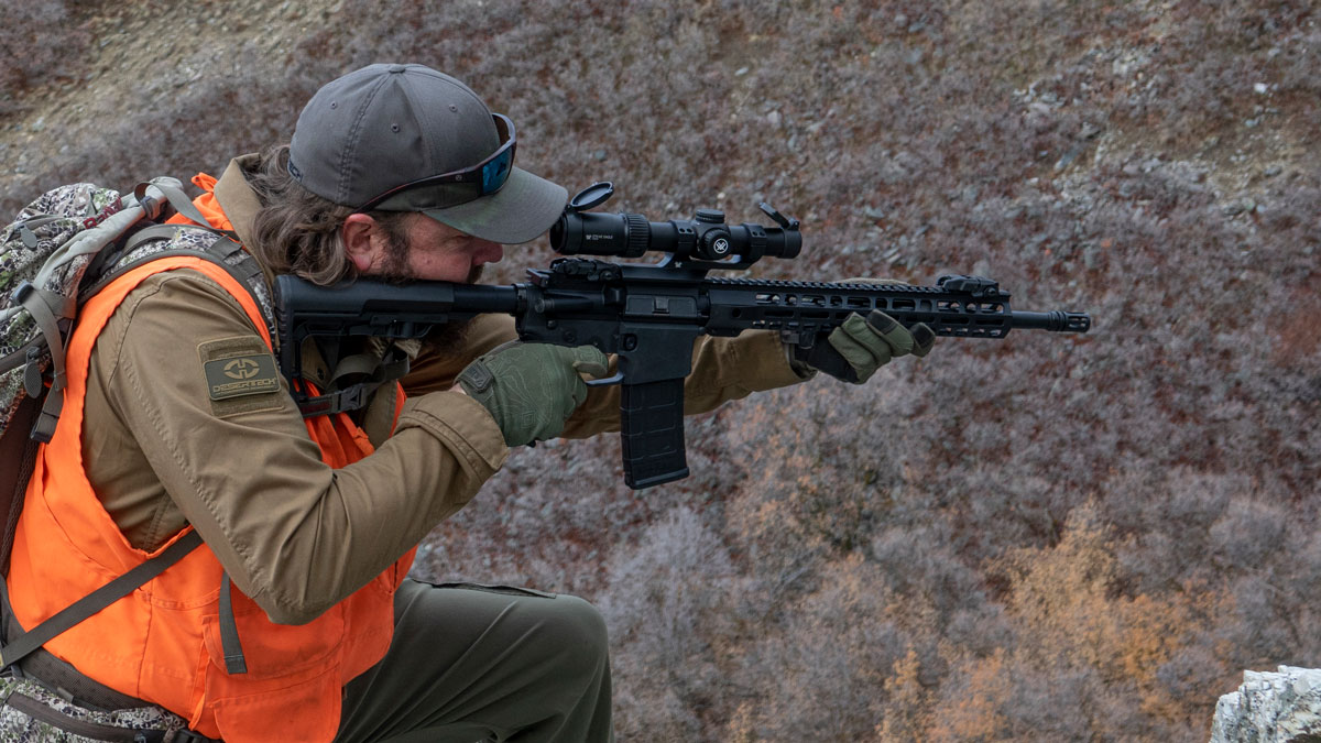 man hunting with an ar style rifle