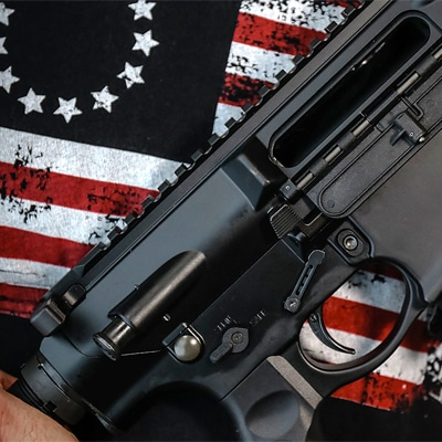 gun on american flag background