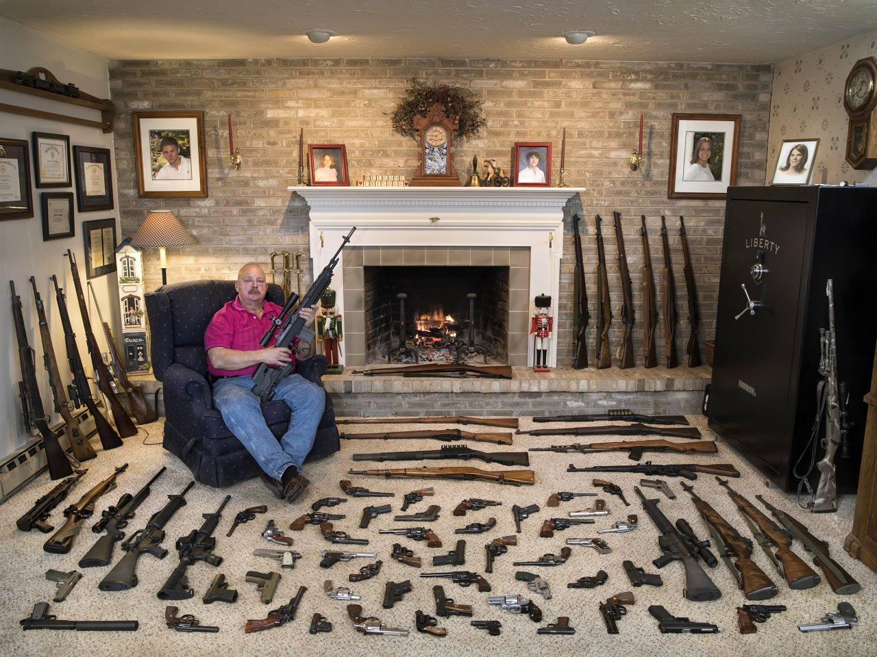 a gentleman with his very respectable gun collection