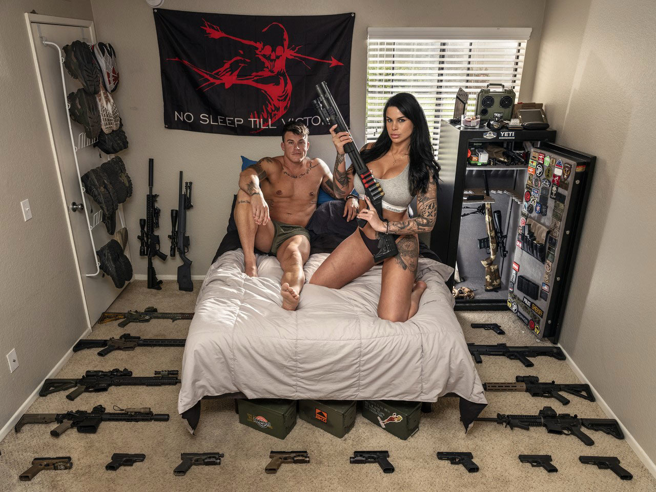 a couple with their guns photographed in Alabama