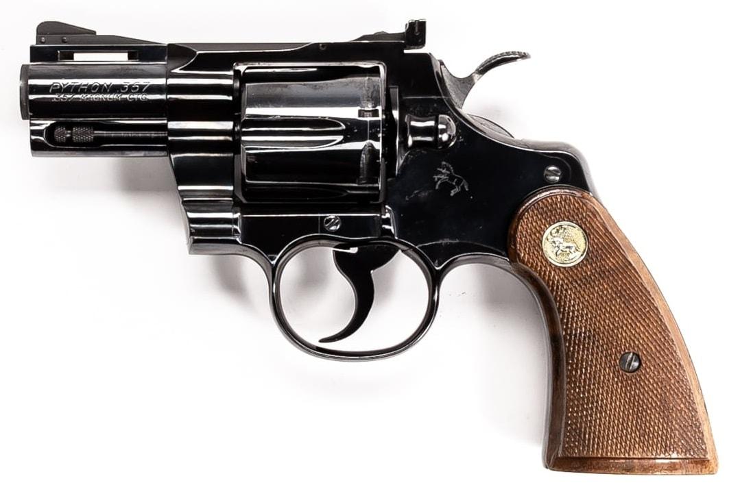 Colt 2.5-inch snub nosed Python revolver in a lightbox