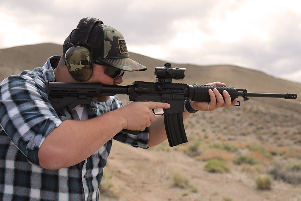 Bushmaster M4 QRC being fired in the desert