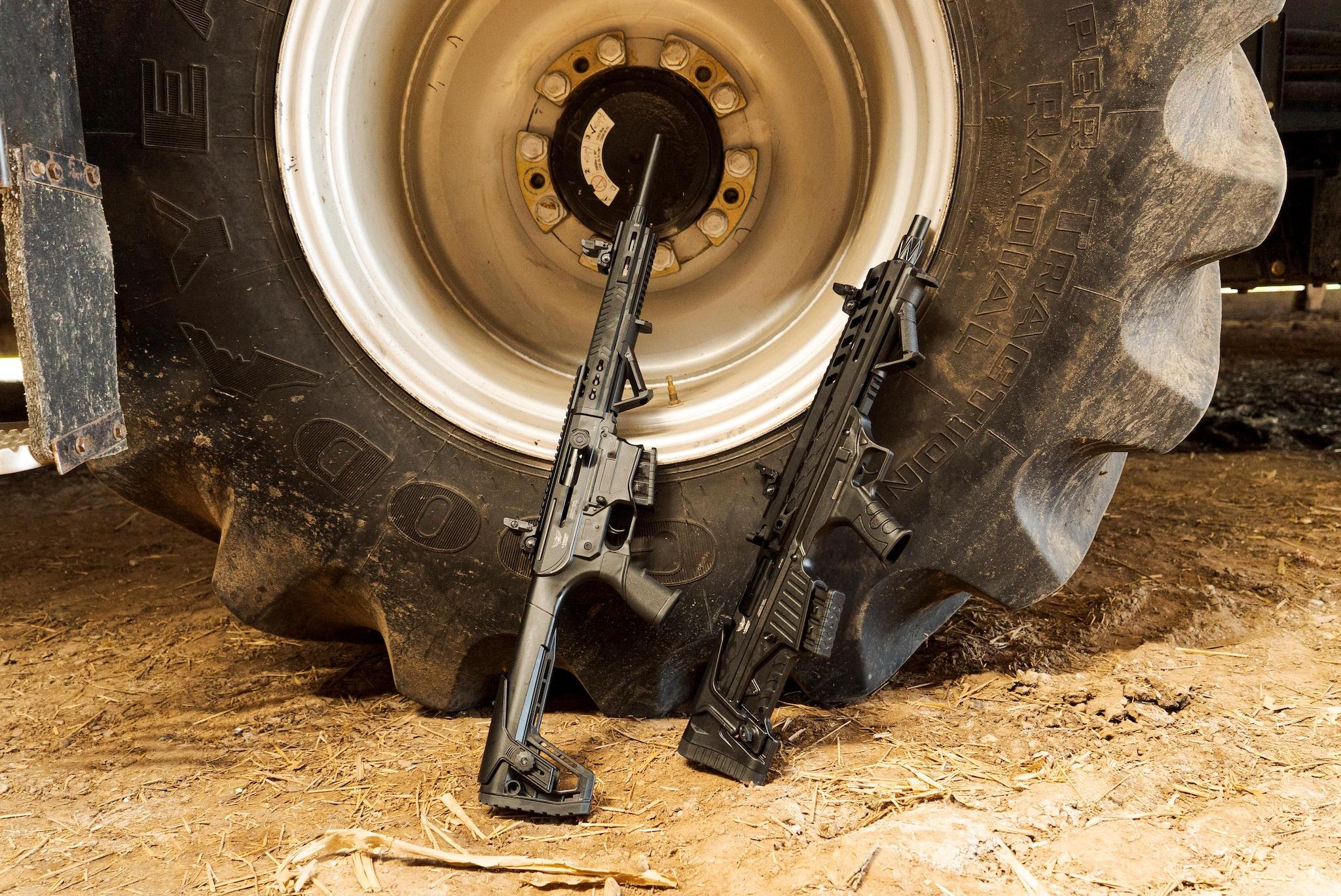 ar-12 shotguns next to large tire