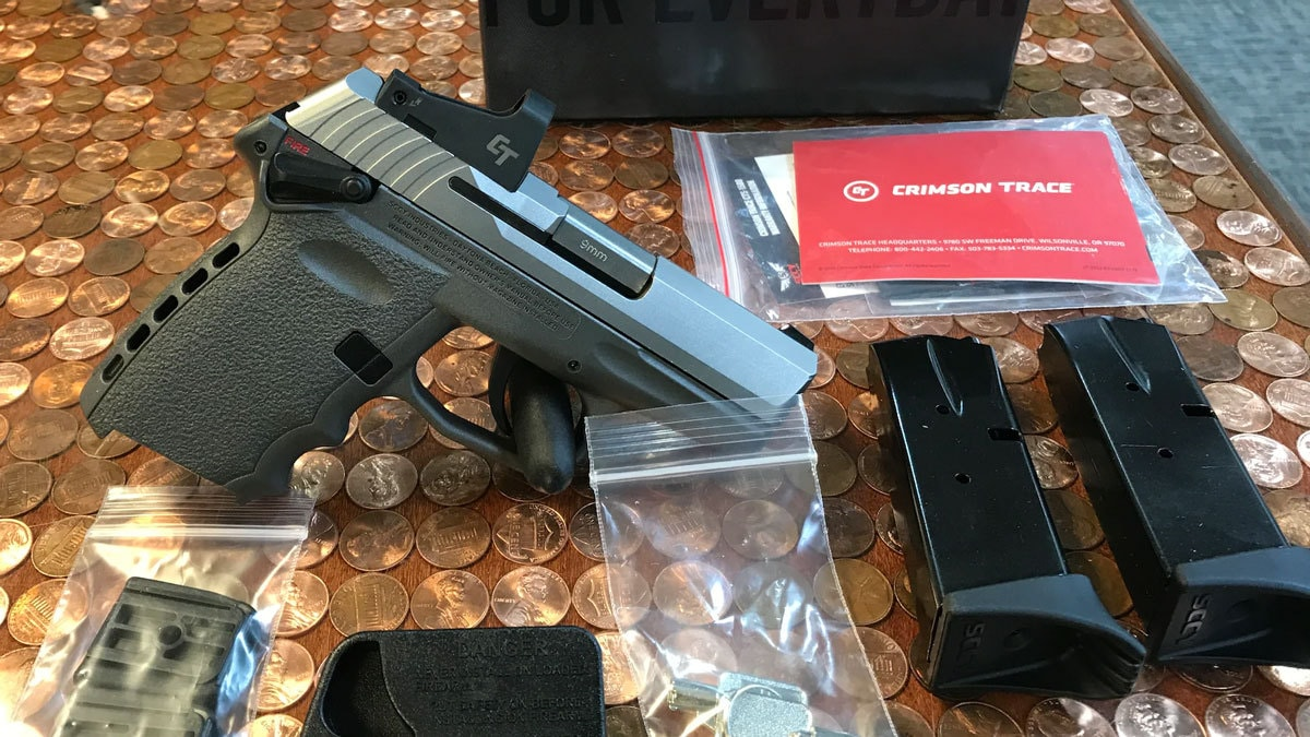SCCY CPX-1 on Table With Mags