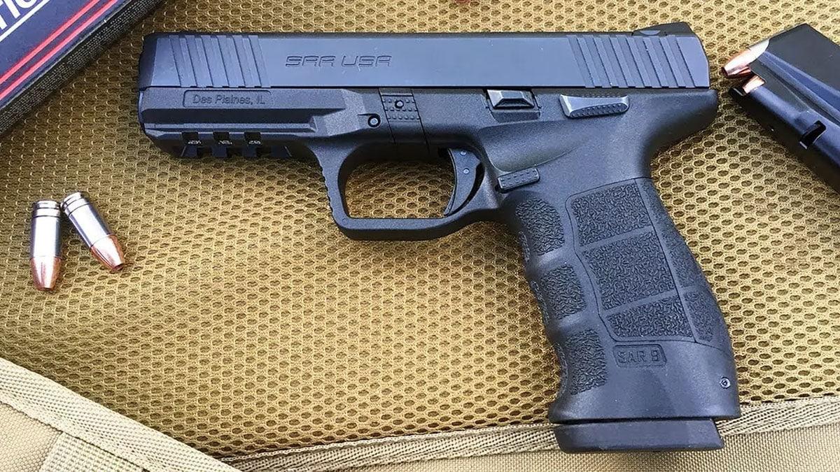 Sarsilmaz Sar 9 Pistol on a range bag