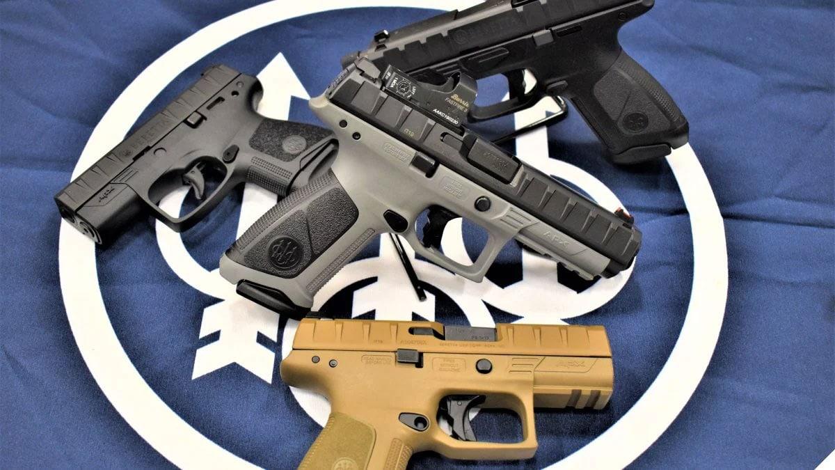Four Beretta APX pistols on a blue flag