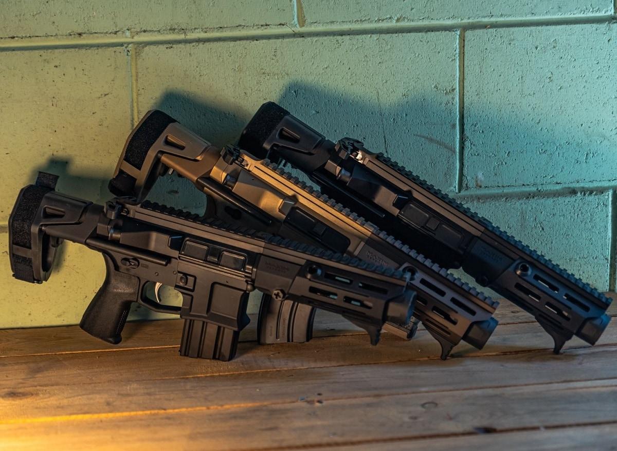 Maxim PDX guns against wall