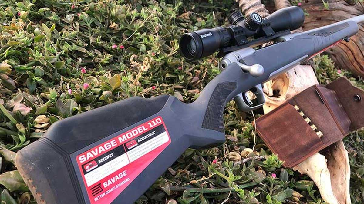 Savage Model 110 with ammo on ground