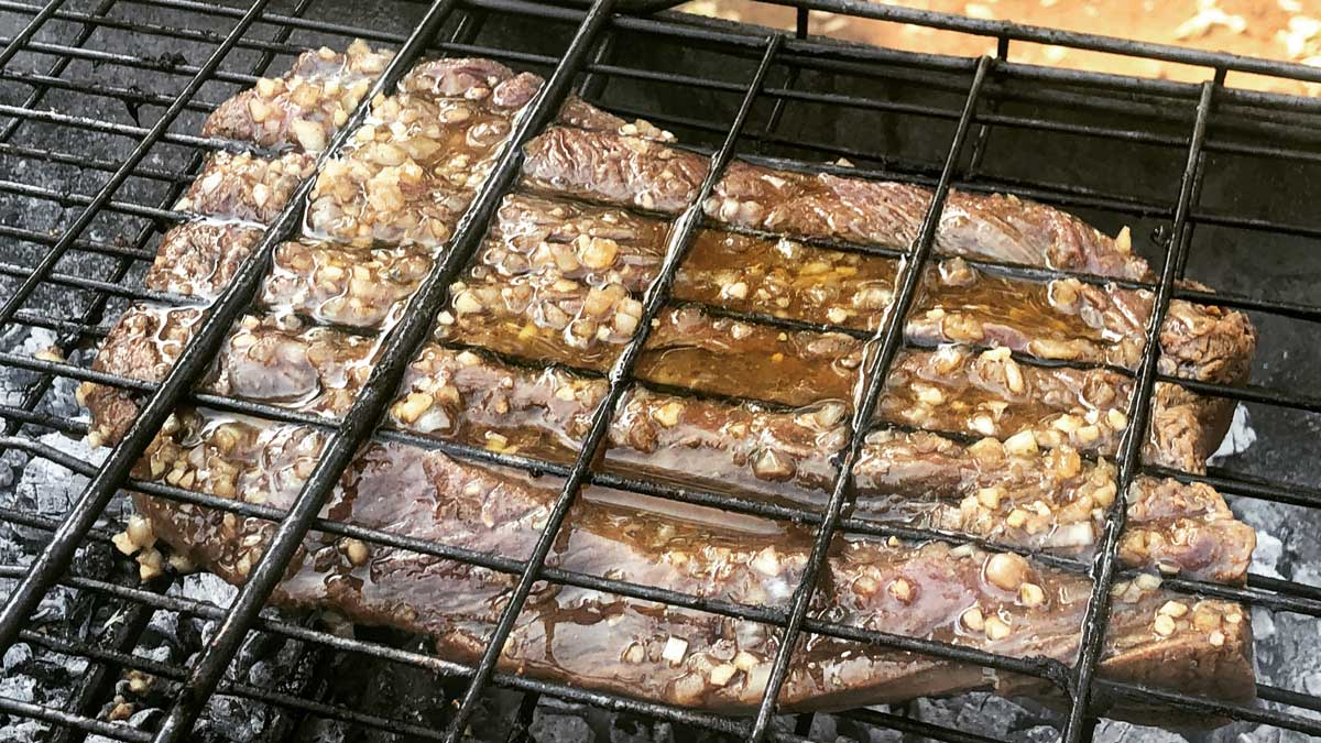 Meat grilling over coals