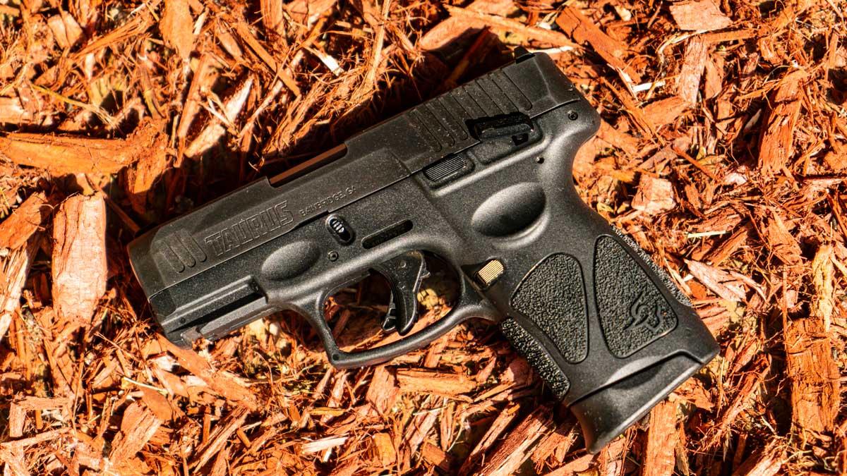 Taurus G3c pistol on red wood chips