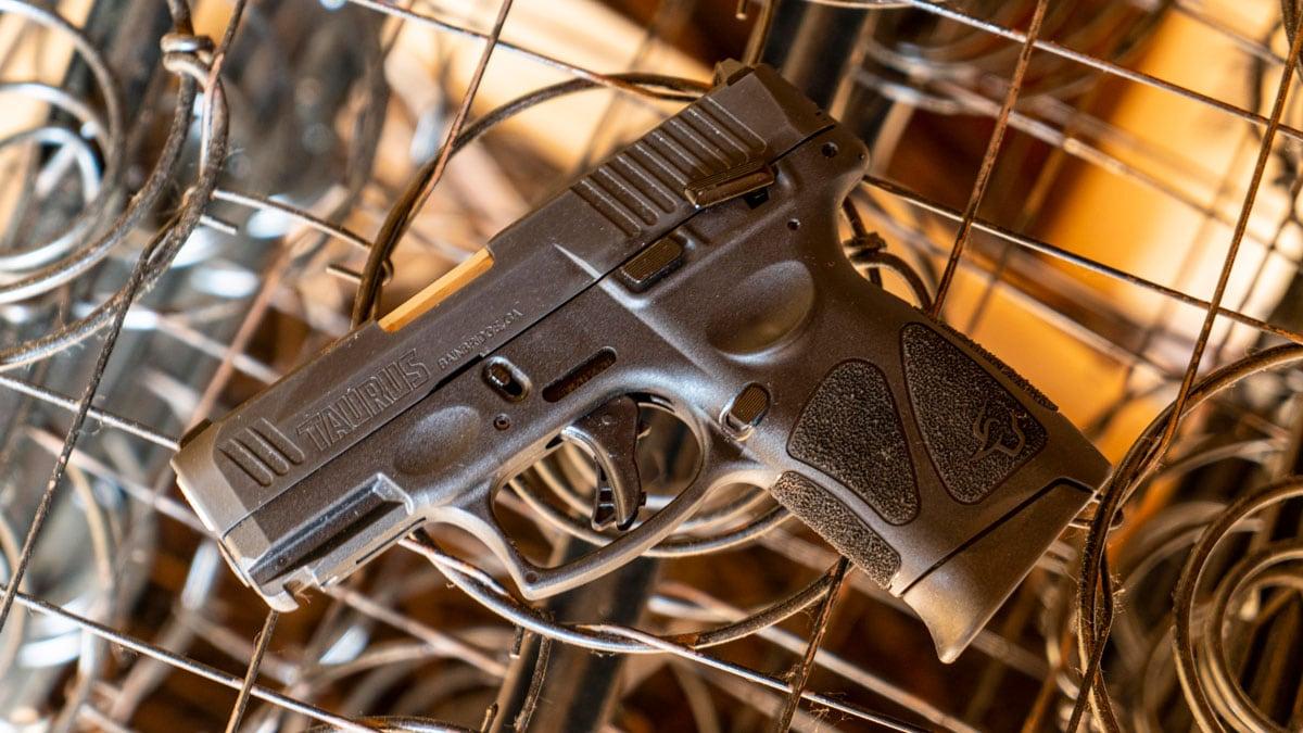 Taurus G3c pistol on metal wires