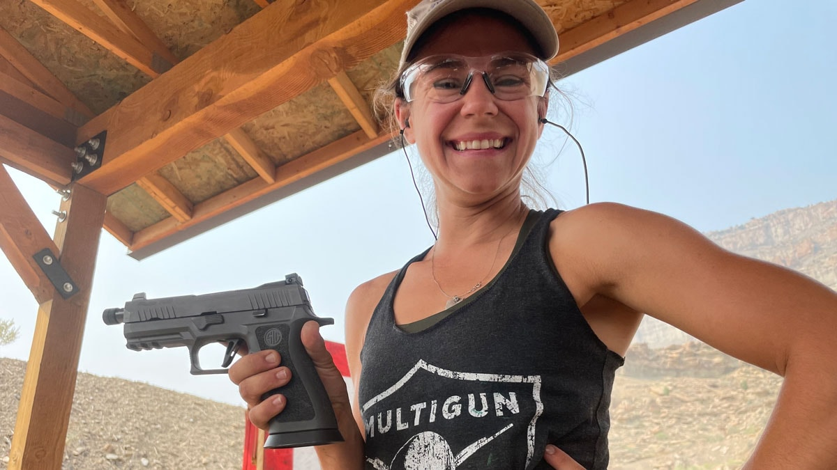 Shooter with Sig Sauer X Carry pistol at the range