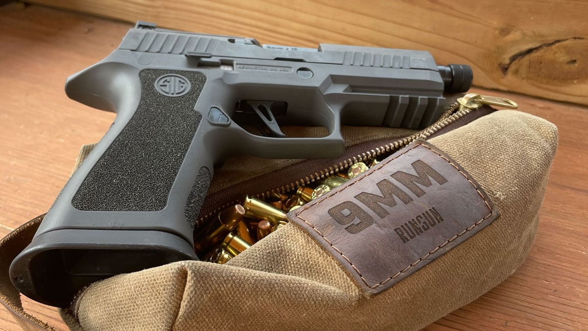 Sig Sauer XCarry with ammo on a table at the range