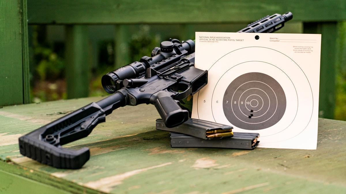 ZRo Delta Rifle with U.S. Optics Scope next to target