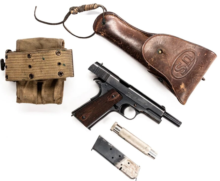 It includes a non-lanyard looped, two-tone magazine. Such magazines have a distinctive finish due to how they were dipped in hot cyanide solution to temper the feed lips after the mag body was blued.