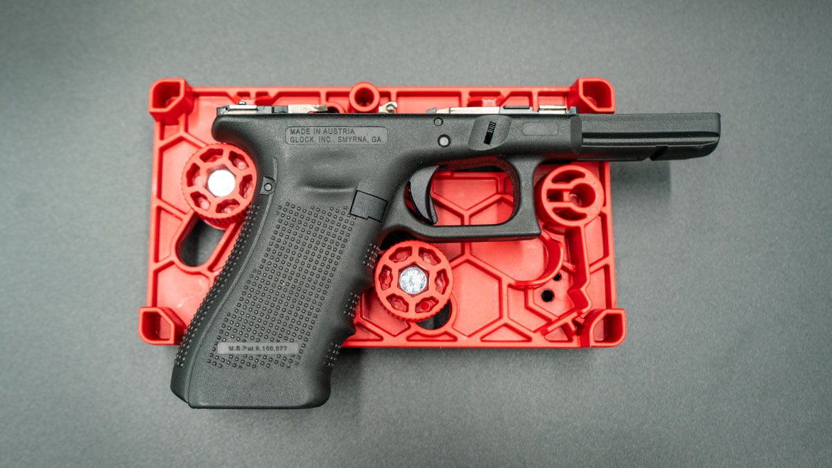 Glock 17 frame rests on a APEX Armorer's Tool