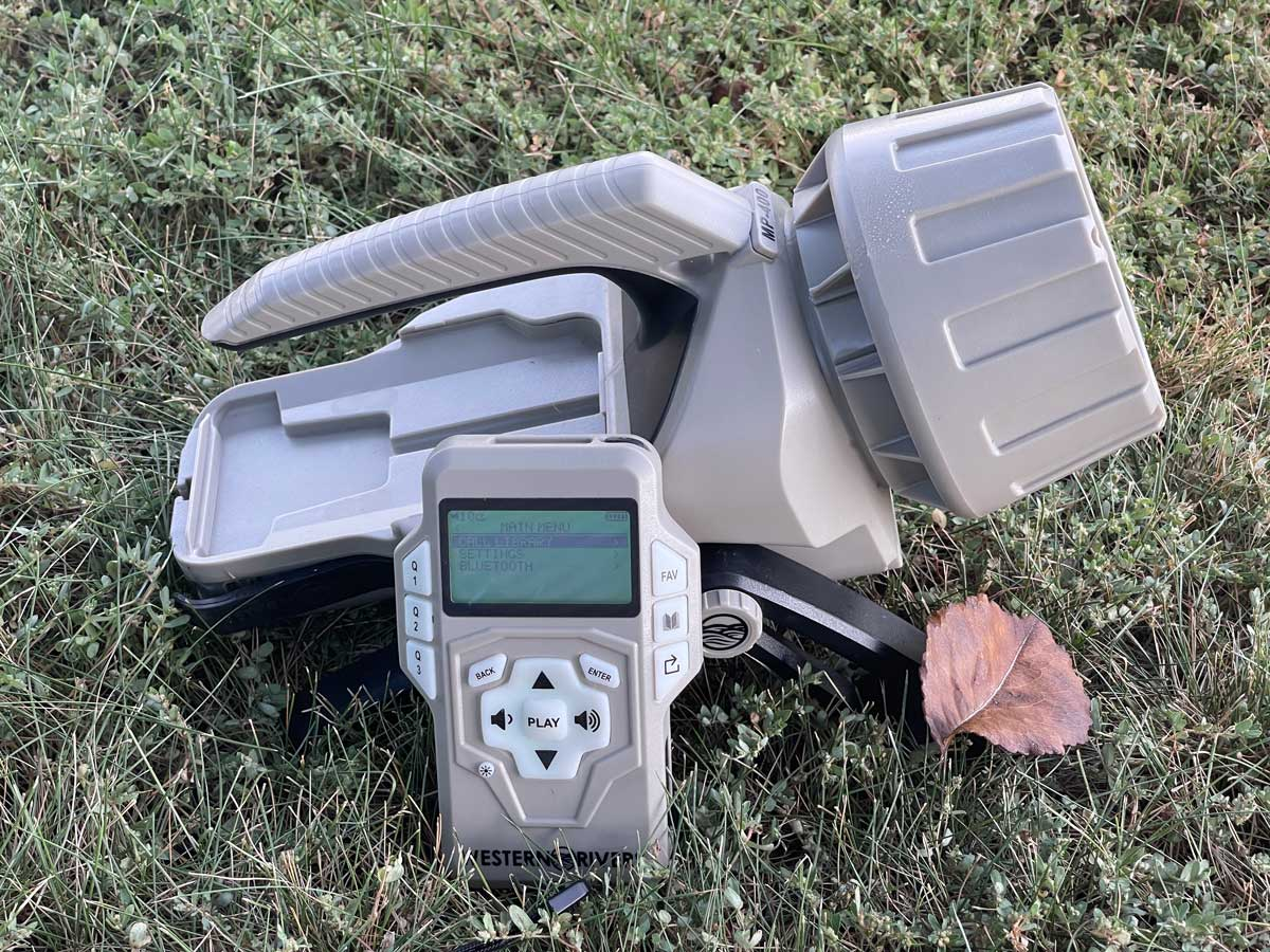 The Mantis Pro 400 electronic game caller and remote controller sit in a field