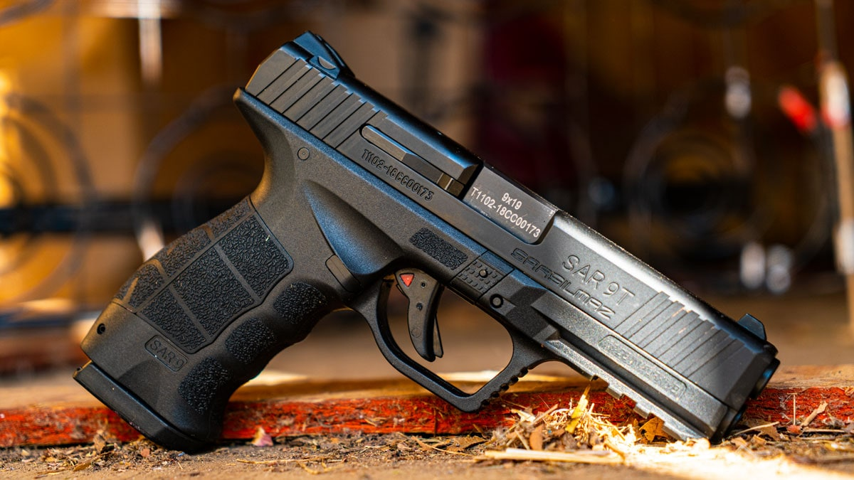 SAR 9 9mm pistol sits on a wooden floor