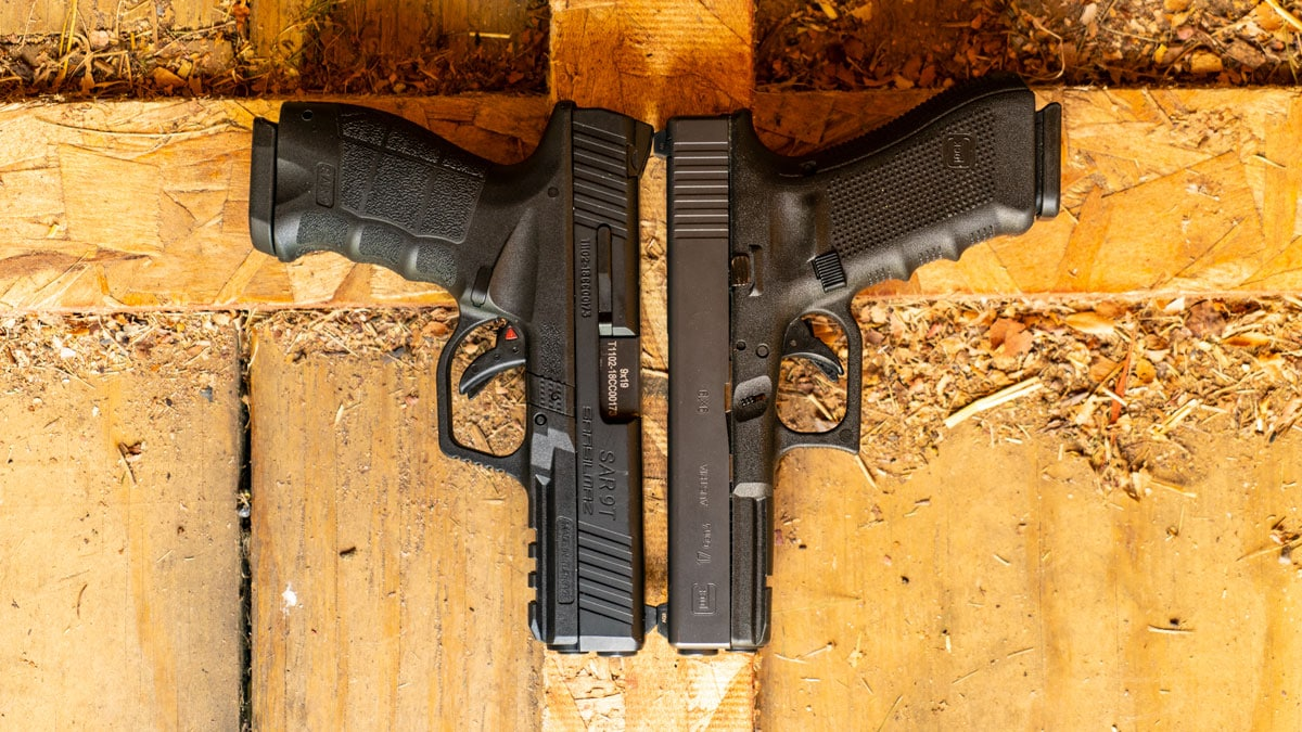 SAR 9 lying next to Glock 17 on wooden floor
