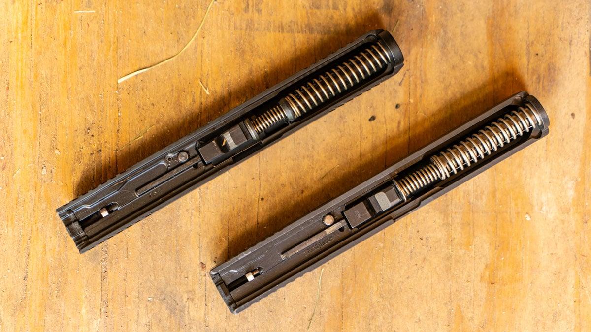 A SAR 9 slide, left, next to a Glock 17 slide