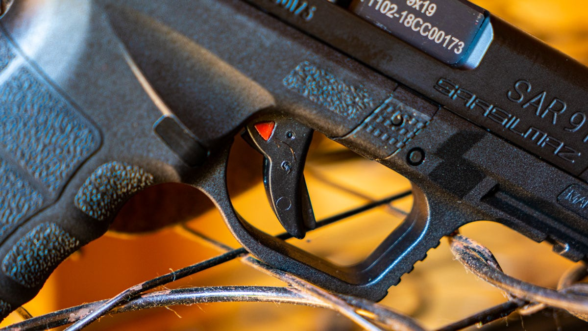 Close view of the SAR 9 trigger and takedown lever