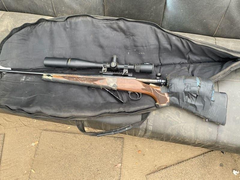 Homeless camp rifle