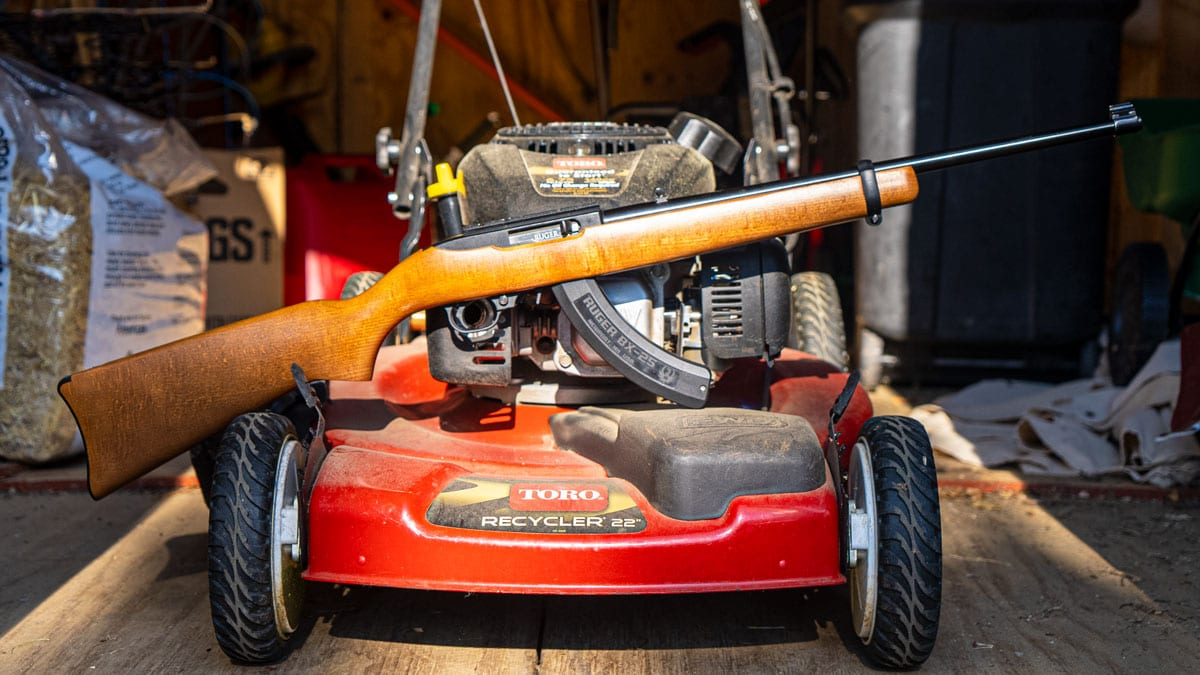 Ruger 10/22 rifle on a lawnmower