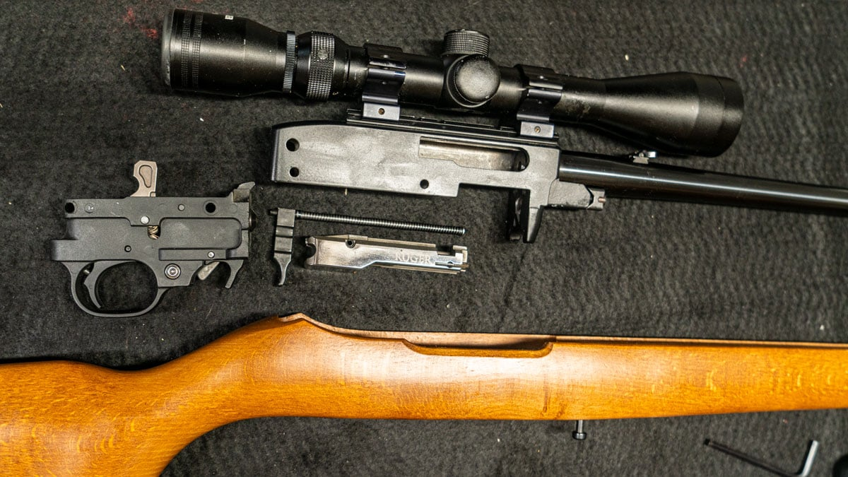Disassembled Ruger 10/22 rifle on a table