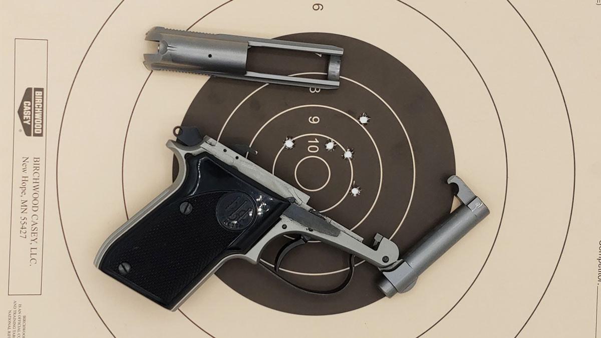 Beretta 21A pistol with target