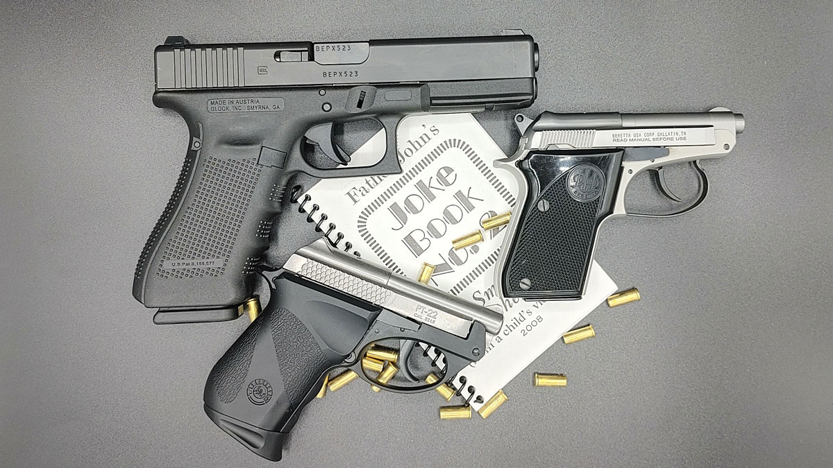 A Beretta 21A next to other pistols
