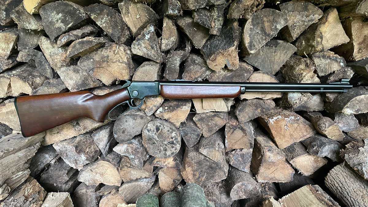 Marlin 39A rifle on a pile of wood