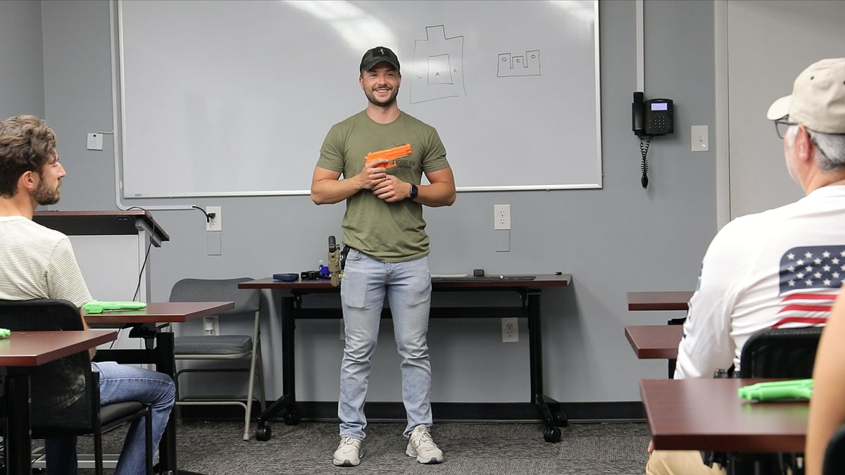 A firearms instructor teaches a class at The Machine Gun Nest