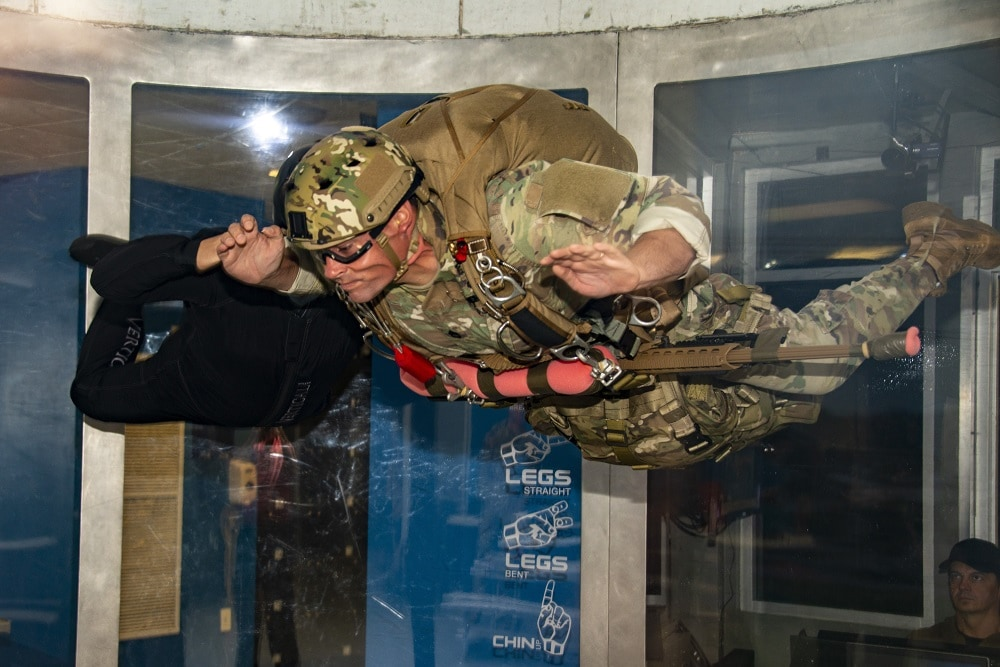 """Special Operations Sniper participating in the MK22 Precision Sniper Rifle (PSR) test conducts vertical wind tunnel testing with his MK22 in the """"front-mount"""" configuration"""