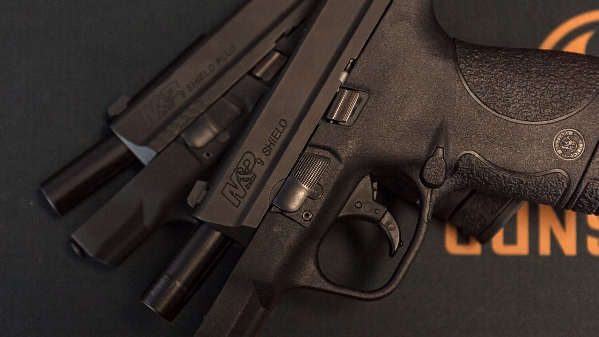 M&P Shield and Shield Plus pistols on a table