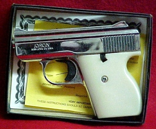Lorcin pistol in its box on red cloth
