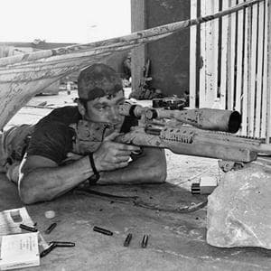 black and white photo of sniper
