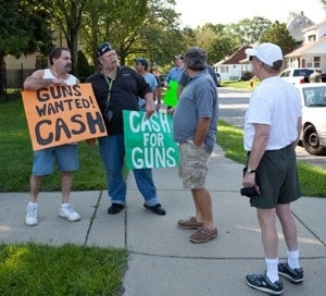 gun advocates with signs