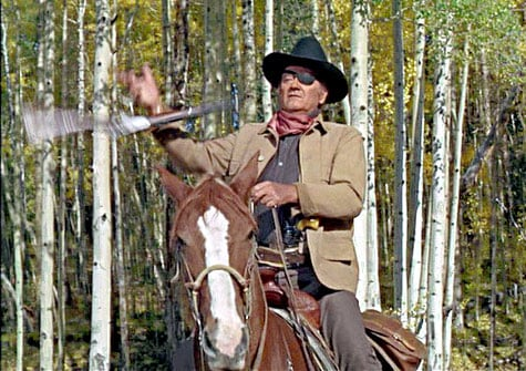 John Wayne twirling a large-loop lever-action rifle