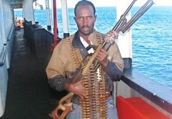 Pirate with gun on boat