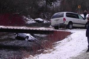 car in water off of bridge